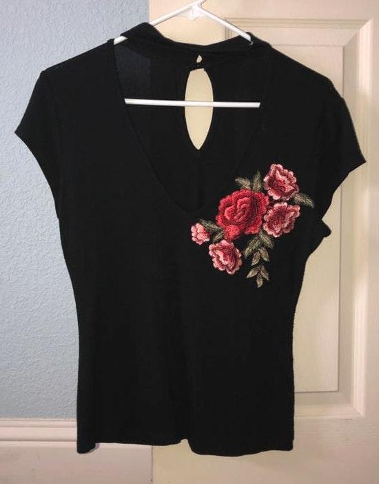 Fashion Magazine Black V Neck With Flower