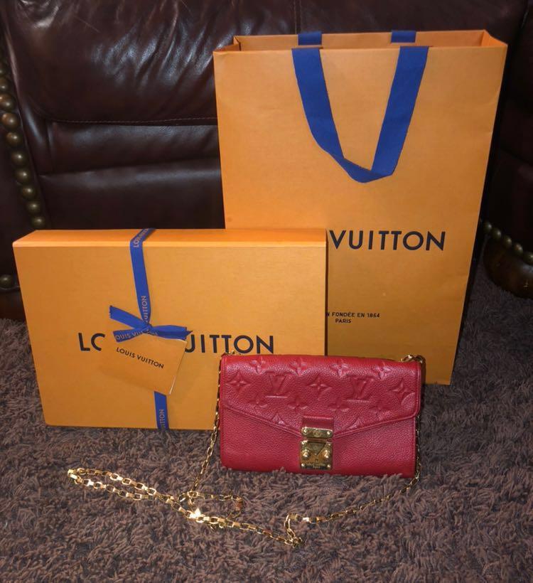 Louis Vuitton   Saint Germain Pochette Empreinte Red Leather Cross Body Bag