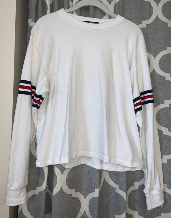 b4b9ab9bdd We're the buy/sell app for cute clothes. Say to being bored of your clothes.  Home Brandy Melville Cropped Long Sleeved White Tee