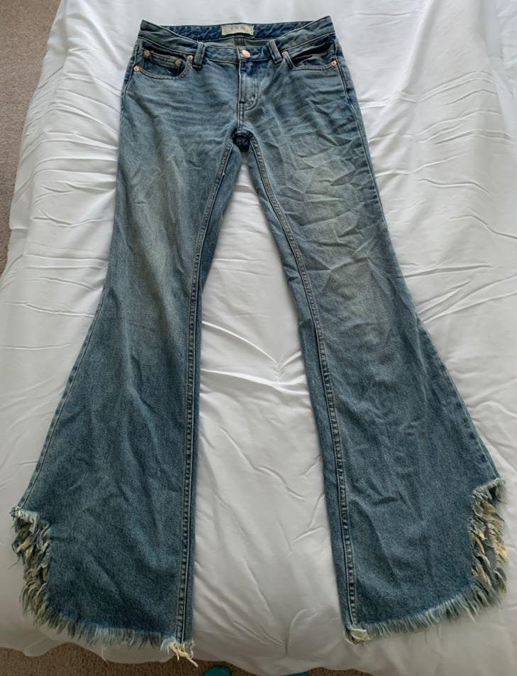 Free People Distressed flare jeans