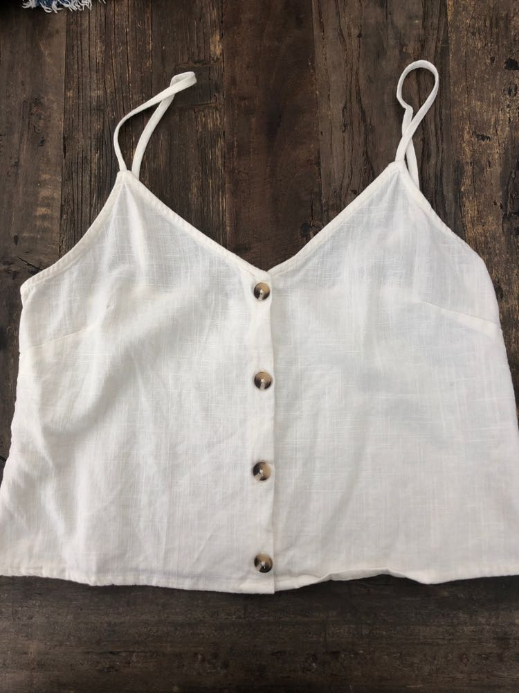 off white linen tank with buttons down the middle