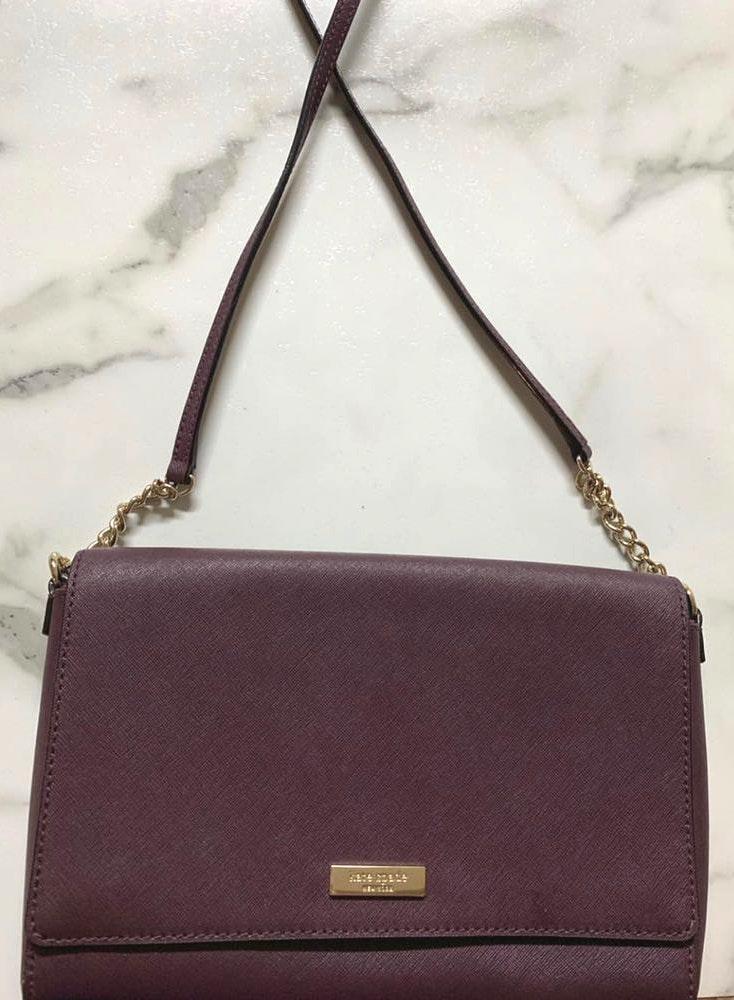 Kate Spade . Maroonish/Dark Purple colored purse