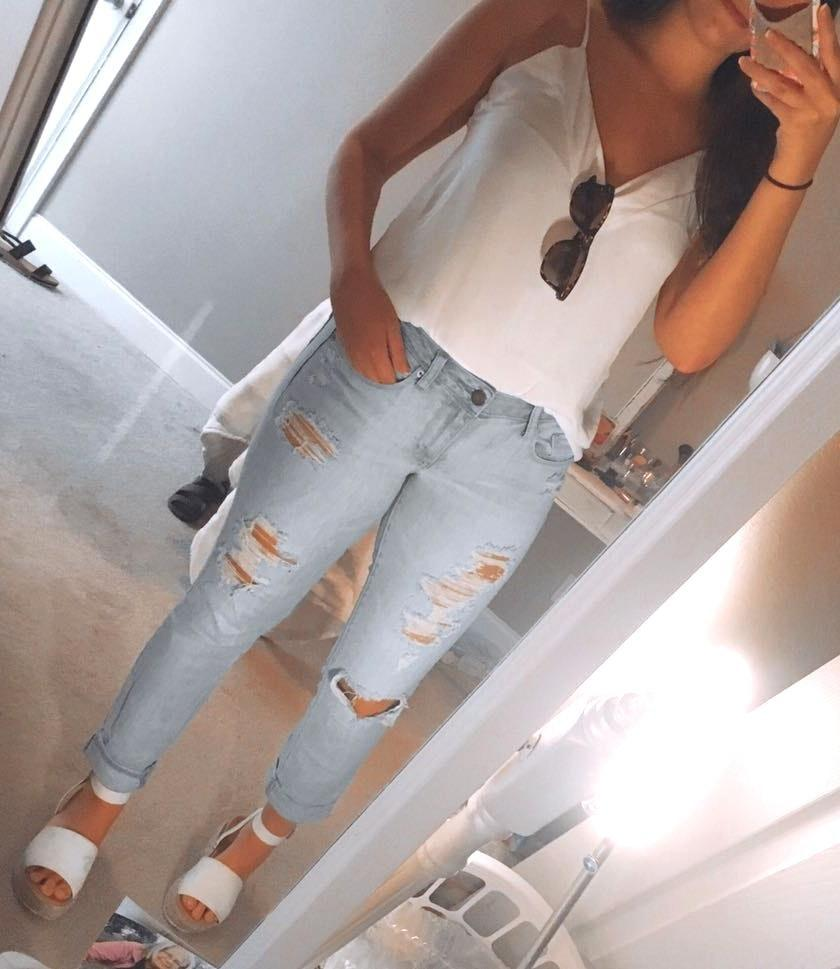 American Eagle Outfitters light wash ripped boyfriend jeans